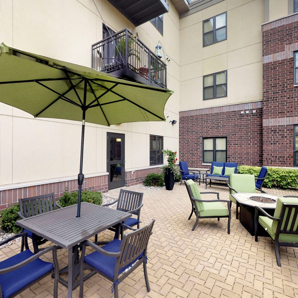 Fire pit with places to relax nearby at Oaks Station Place in Minneapolis, Minnesota