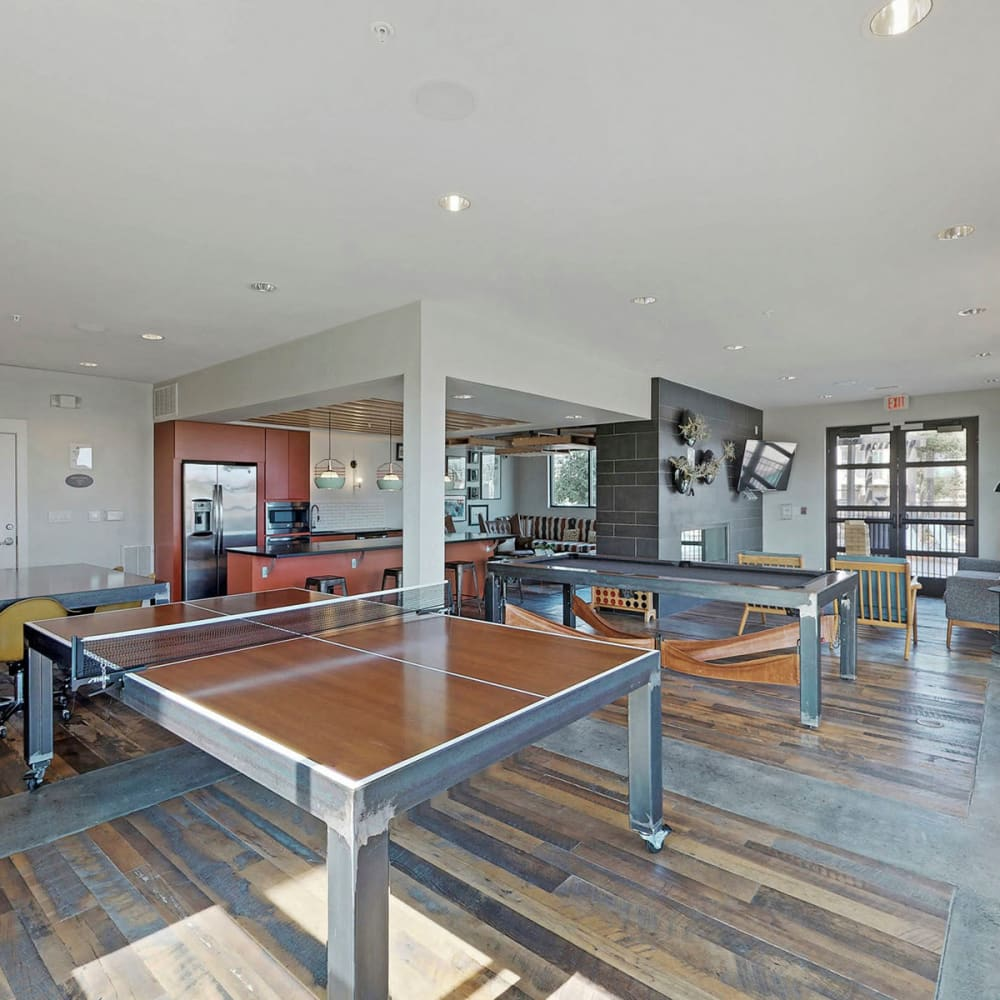 Game area with a ping pong table and more in the clubhouse at Oaks Trinity in Dallas, Texas