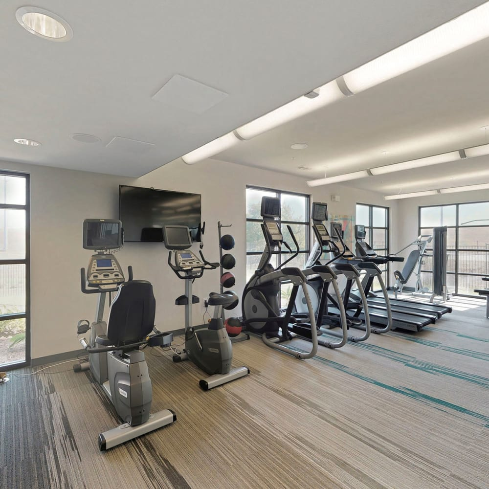 Wide variety of cardio machines in the fitness center at Oaks Trinity in Dallas, Texas