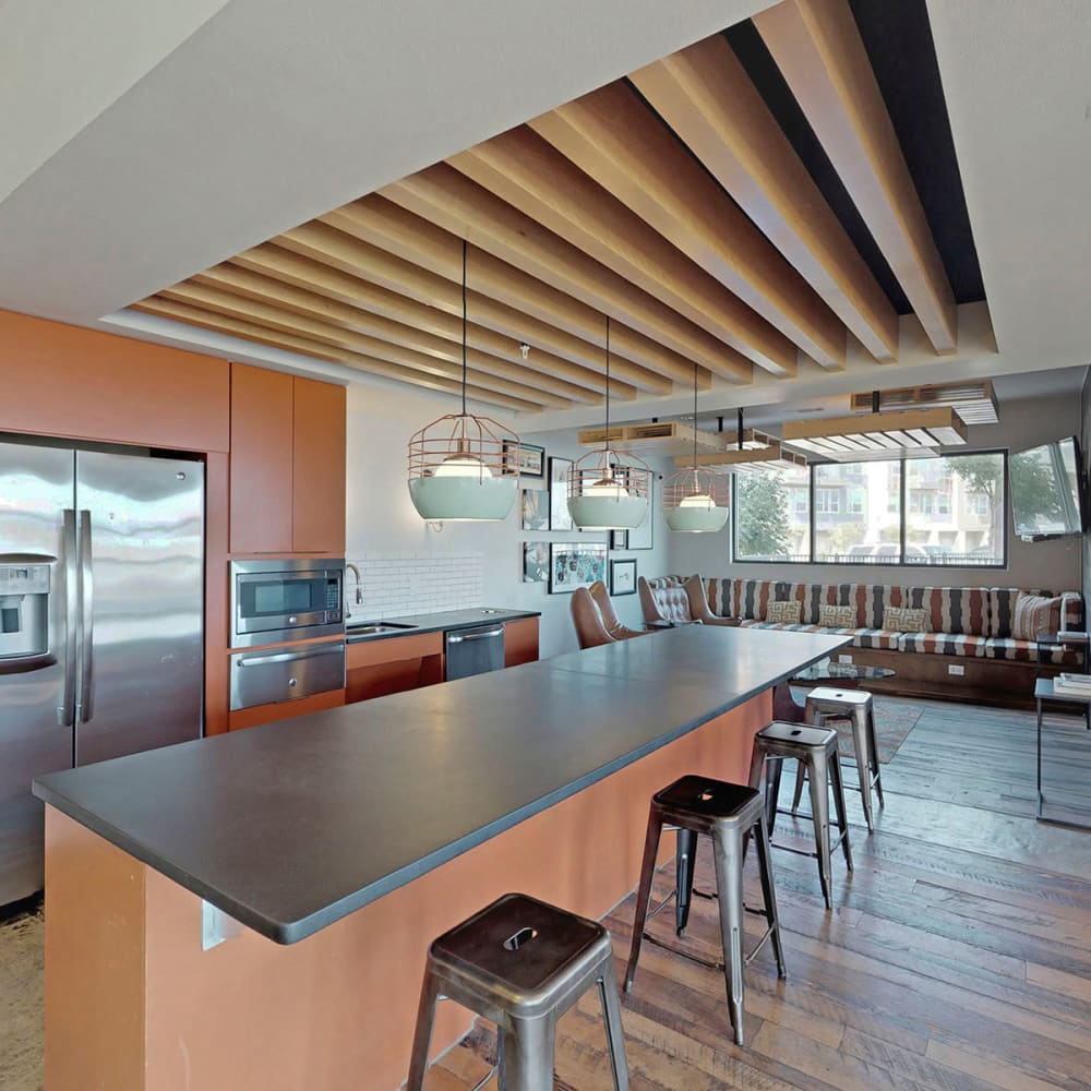 Demonstration kitchen with bar seating in the clubhouse at Oaks Trinity in Dallas, Texas