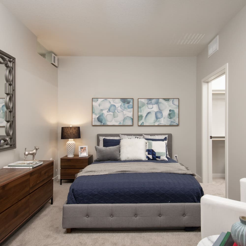 Model home's primary bedroom with plush carpeting and modern furnishings at Oaks Union Depot in St. Paul, Minnesota