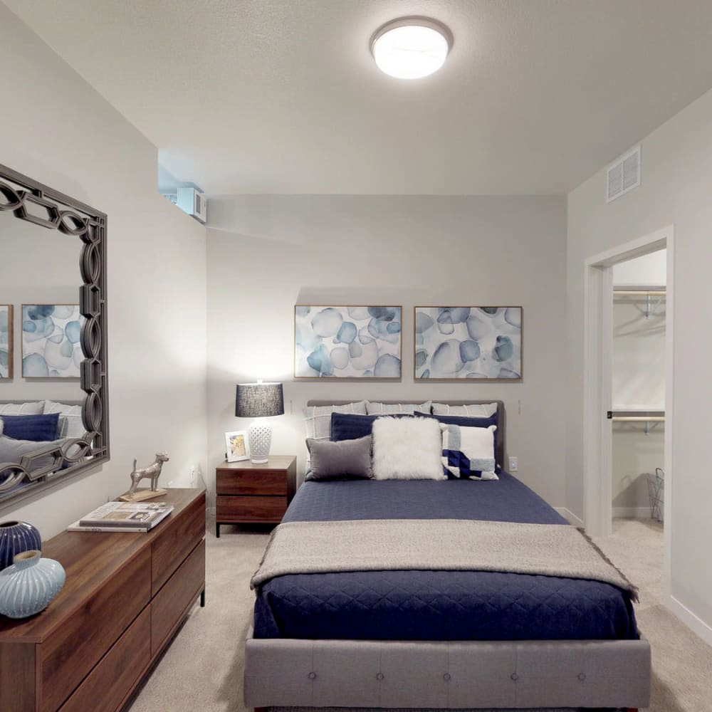 Well-furnished model home's primary bedroom with plush carpeting at Oaks Union Depot in St. Paul, Minnesota