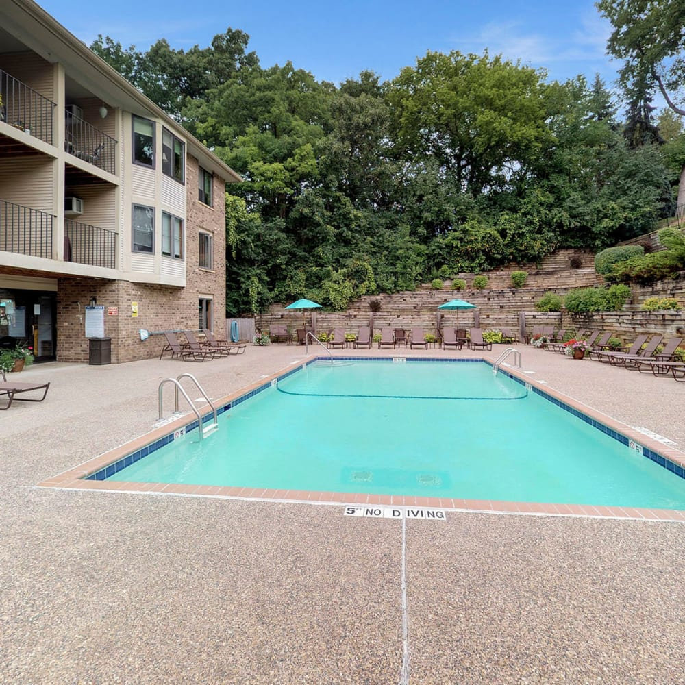 Mature trees and professionally maintained landscaping near the pool at Oaks Vernon in Edina, Minnesota
