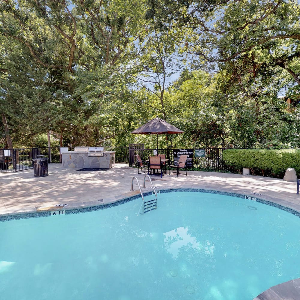 Park-like setting around the swimming pool at Oaks White Rock in Dallas, Texas