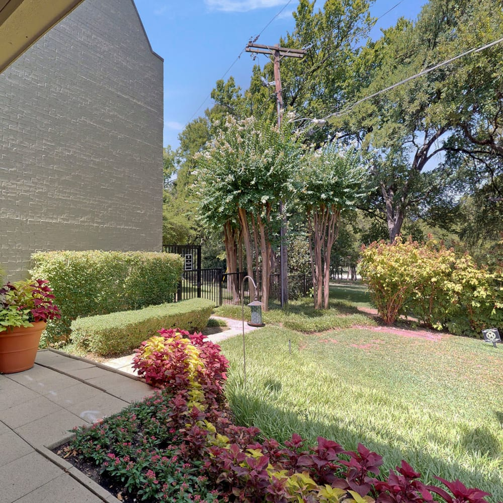 Professionally maintained landscaping throughout the community at Oaks White Rock in Dallas, Texas