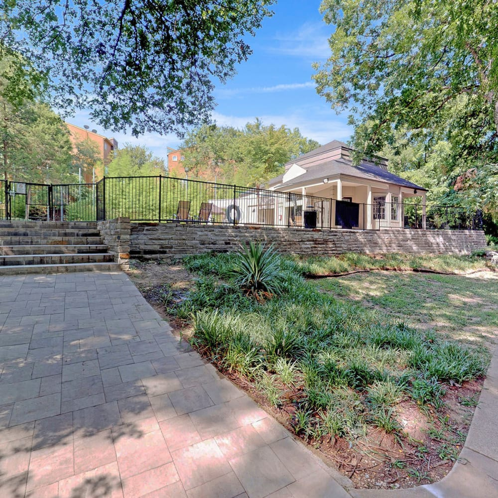 Pathways leading up to the swimming pool area at Oaks White Rock in Dallas, Texas