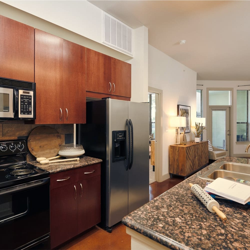 Gourmet kitchen with custom wood cabinetry in a model home at Seville Uptown in Dallas, Texas