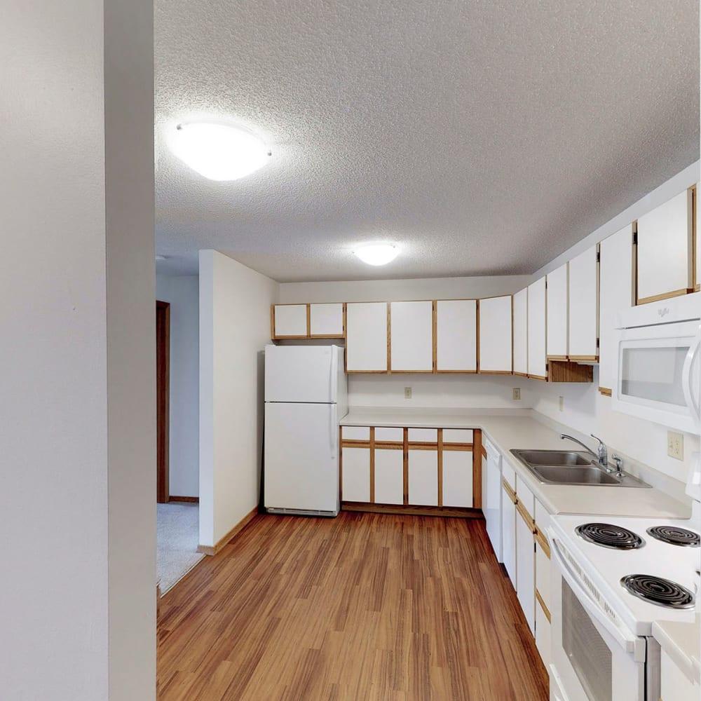 Beautiful bright kitchen at Oaks Lincoln Apartments & Townhomes in Edina, Minnesota