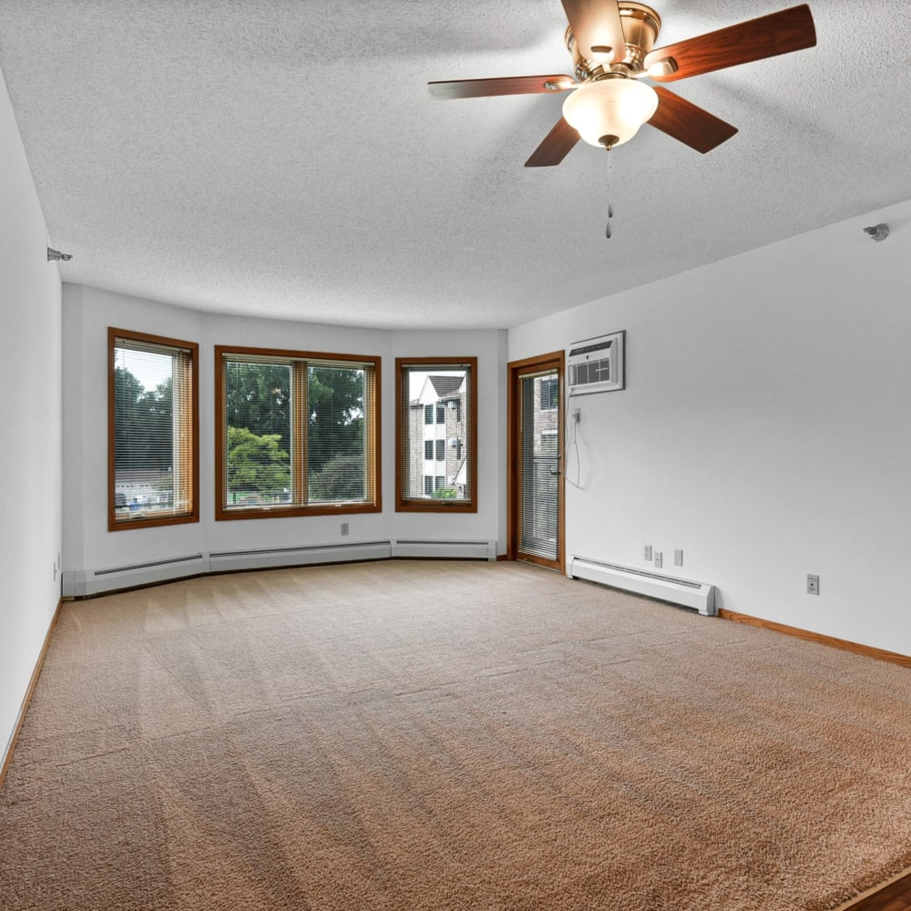 Large living room windows at Oaks Lincoln Apartments & Townhomes in Edina, Minnesota