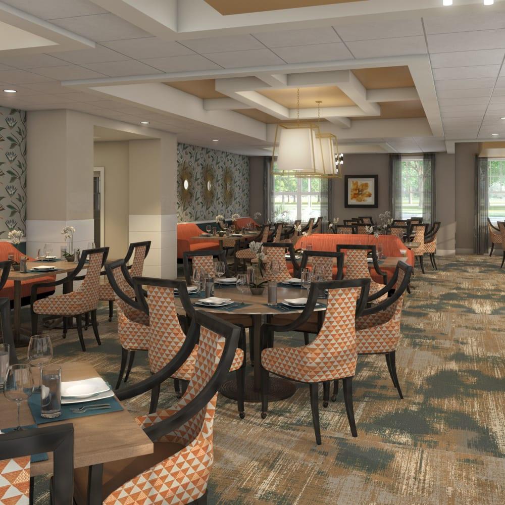 Evening view of dining room at Anthology of Farmington Hills in Farmington Hills, Michigan