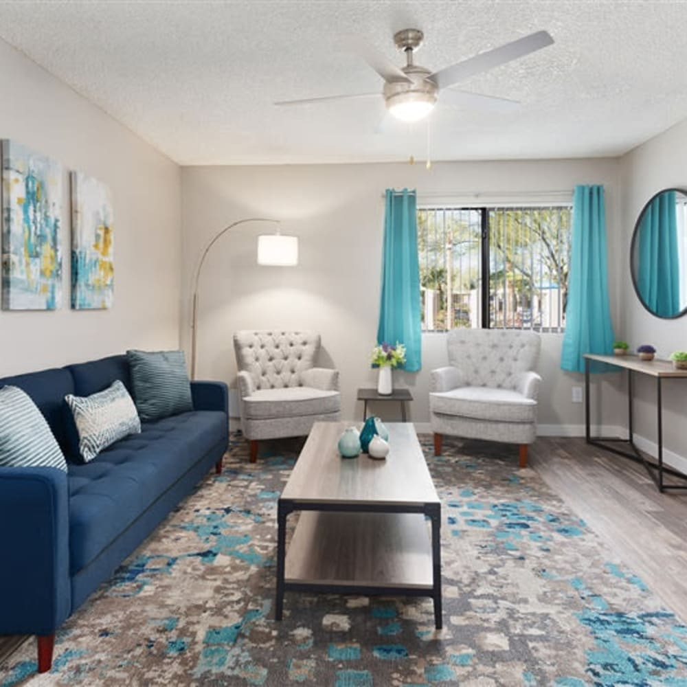 A spacious living room with a ceiling fan at 1408 Casitas at Palm Valley in Avondale, Arizona
