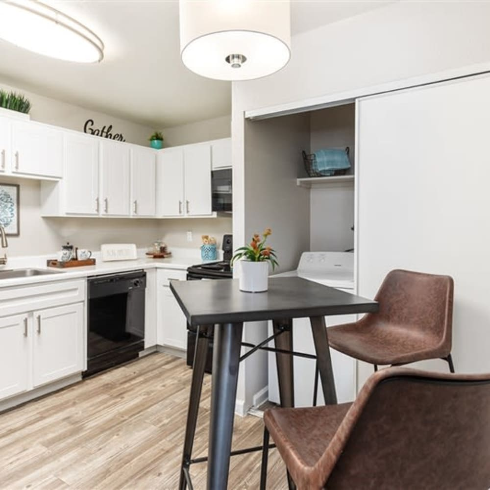 A kitchen with white cabinets at Argenta Apartments in Mesa, Arizona