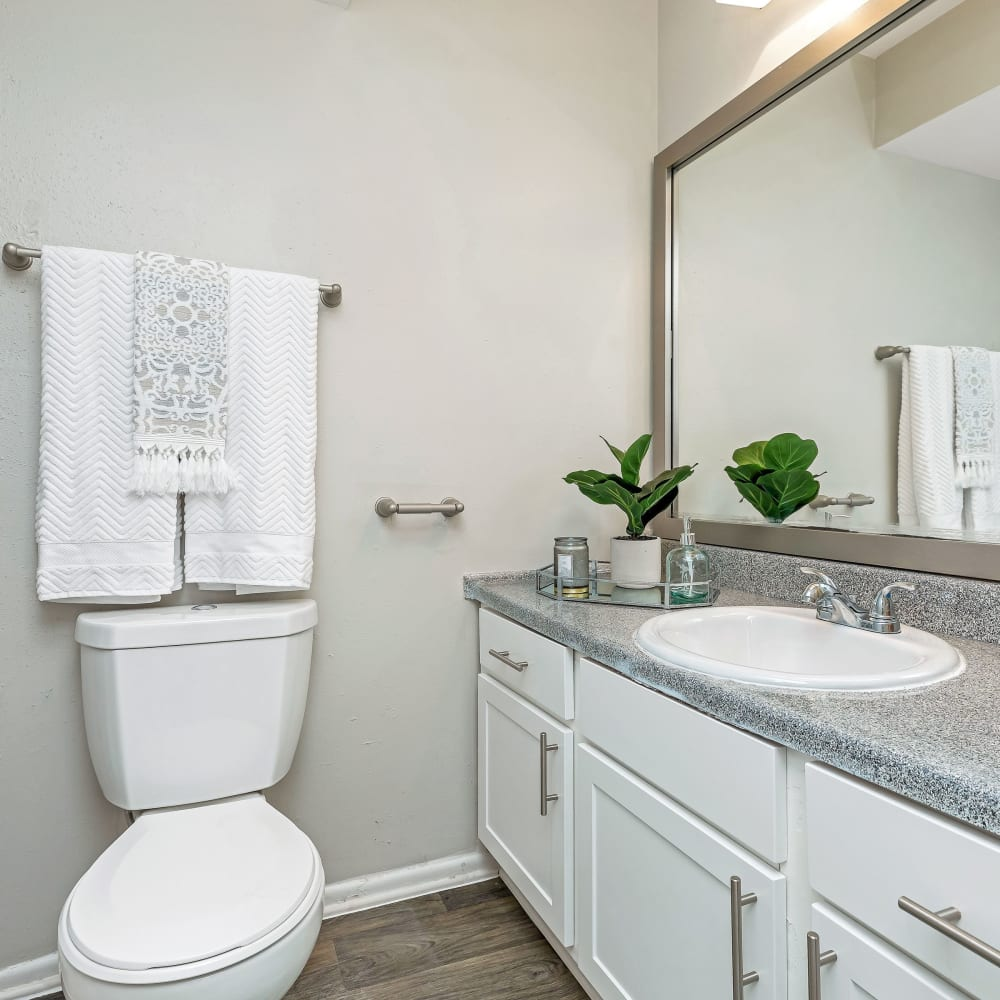 A spacious bathroom with a large vanity at Barringer Square in Webster, Texas