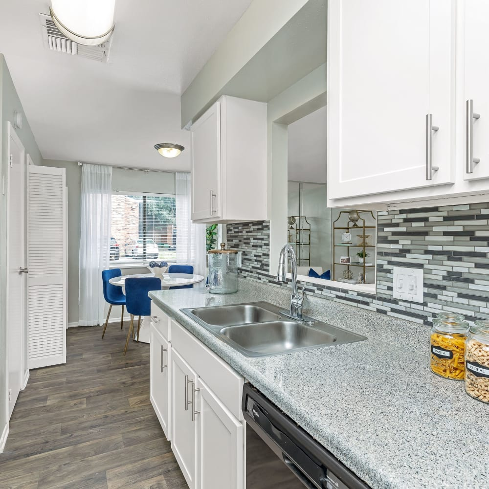 A large kitchen with white appliances at Barringer Square in Webster, Texas