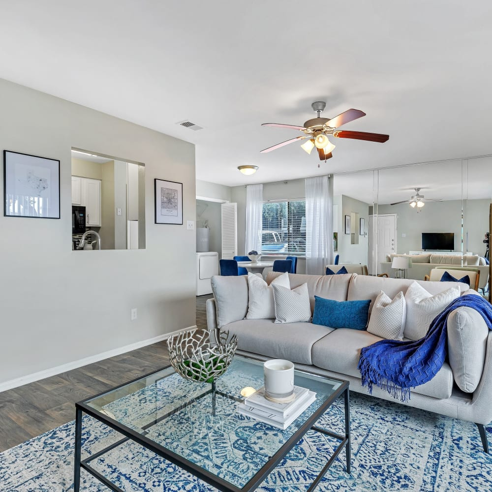 A spacious living with hardwood flooring at Barringer Square in Webster, Texas
