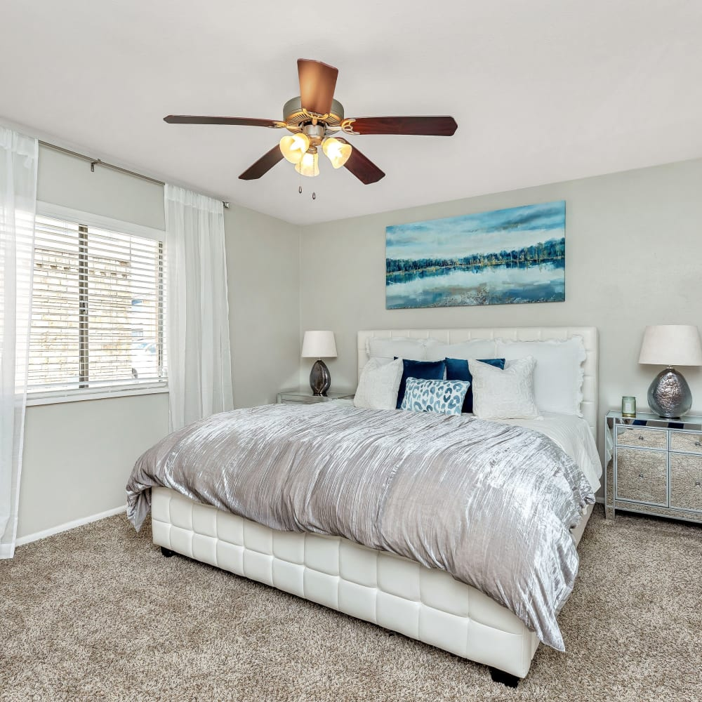 A spacious bedroom with plush carpeting at Barringer Square in Webster, Texas