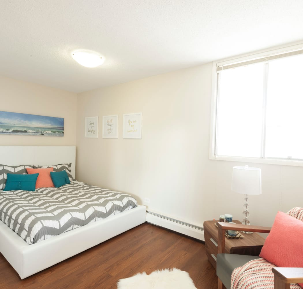 Enjoy a cozy bedroom at Calgary Place Apartments