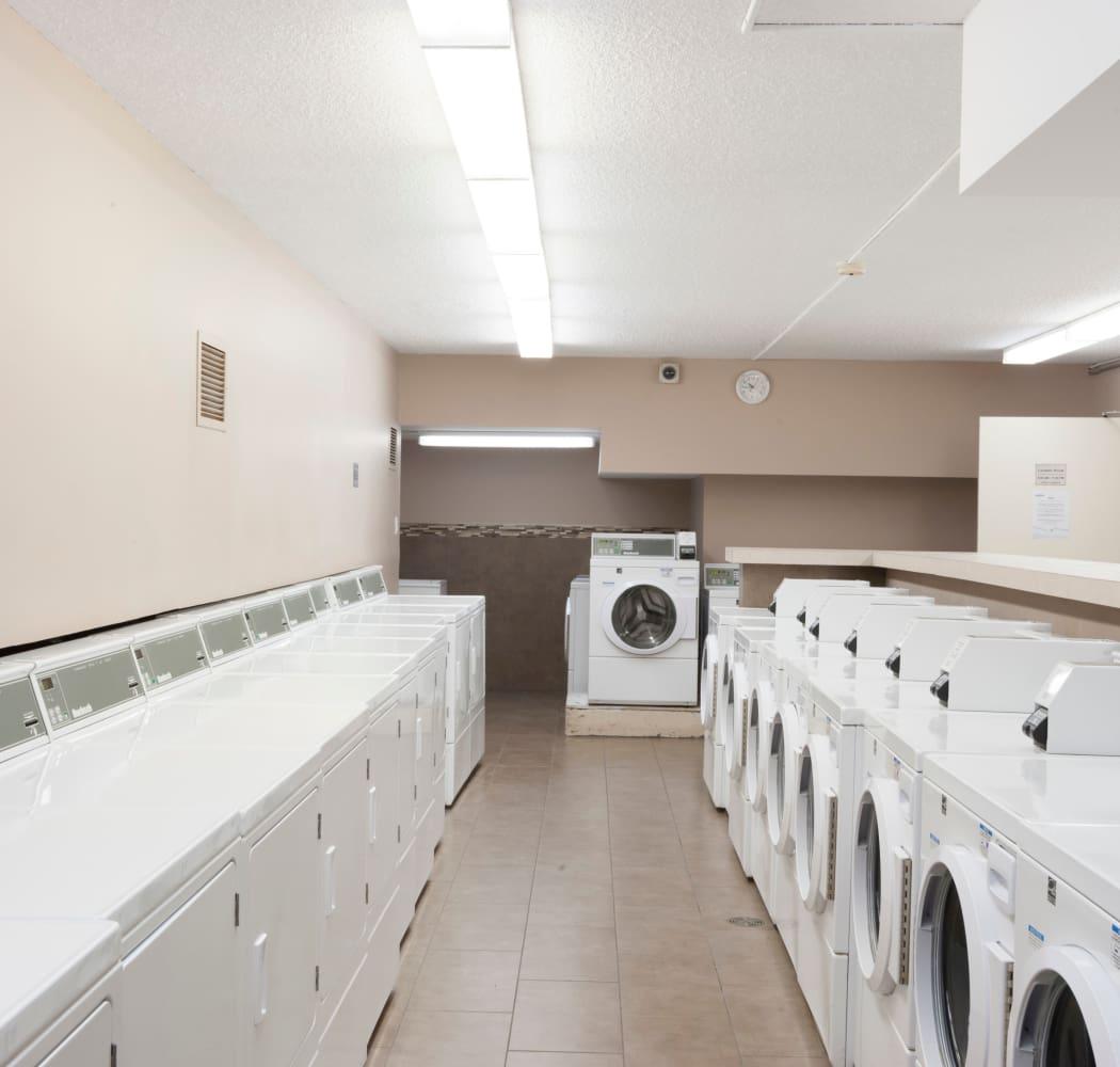 Laundry facility at Calgary Place Apartments in Calgary