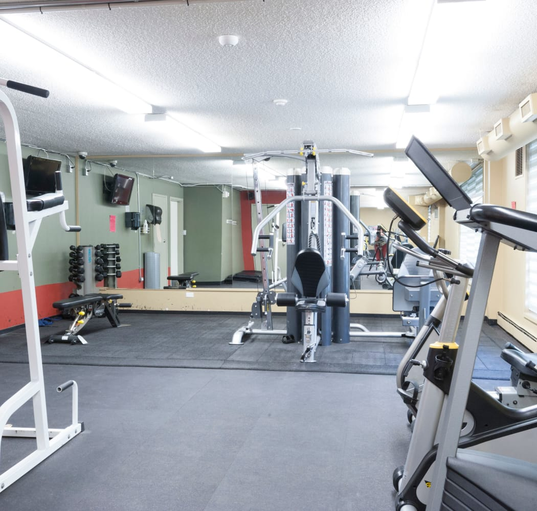 Fitness center at Calgary Place Apartments in Calgary