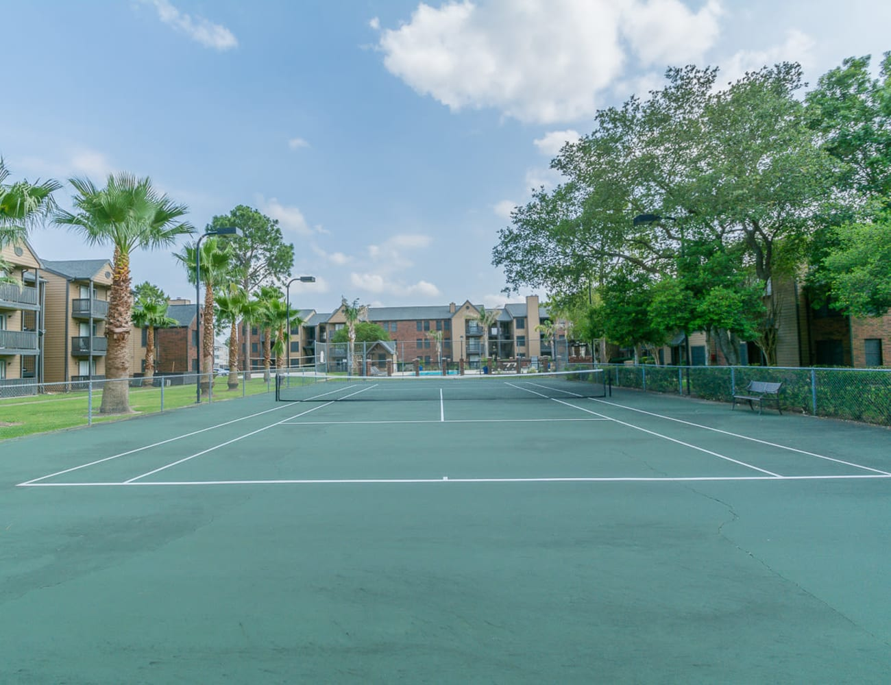 Beautiful outdoor tennis court at Hayden at Enclave in Houston, Texas