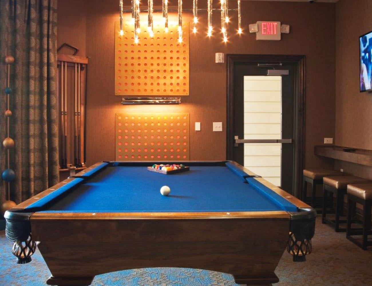 Resident clubhouse with billiards table and more at The Blvd in Irving, Texas