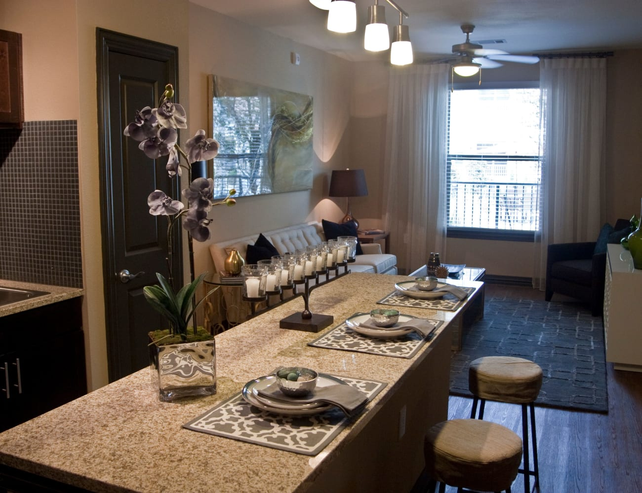 Kitchen with a breakfast bar and hardwood floors at The Blvd in Irving, Texas