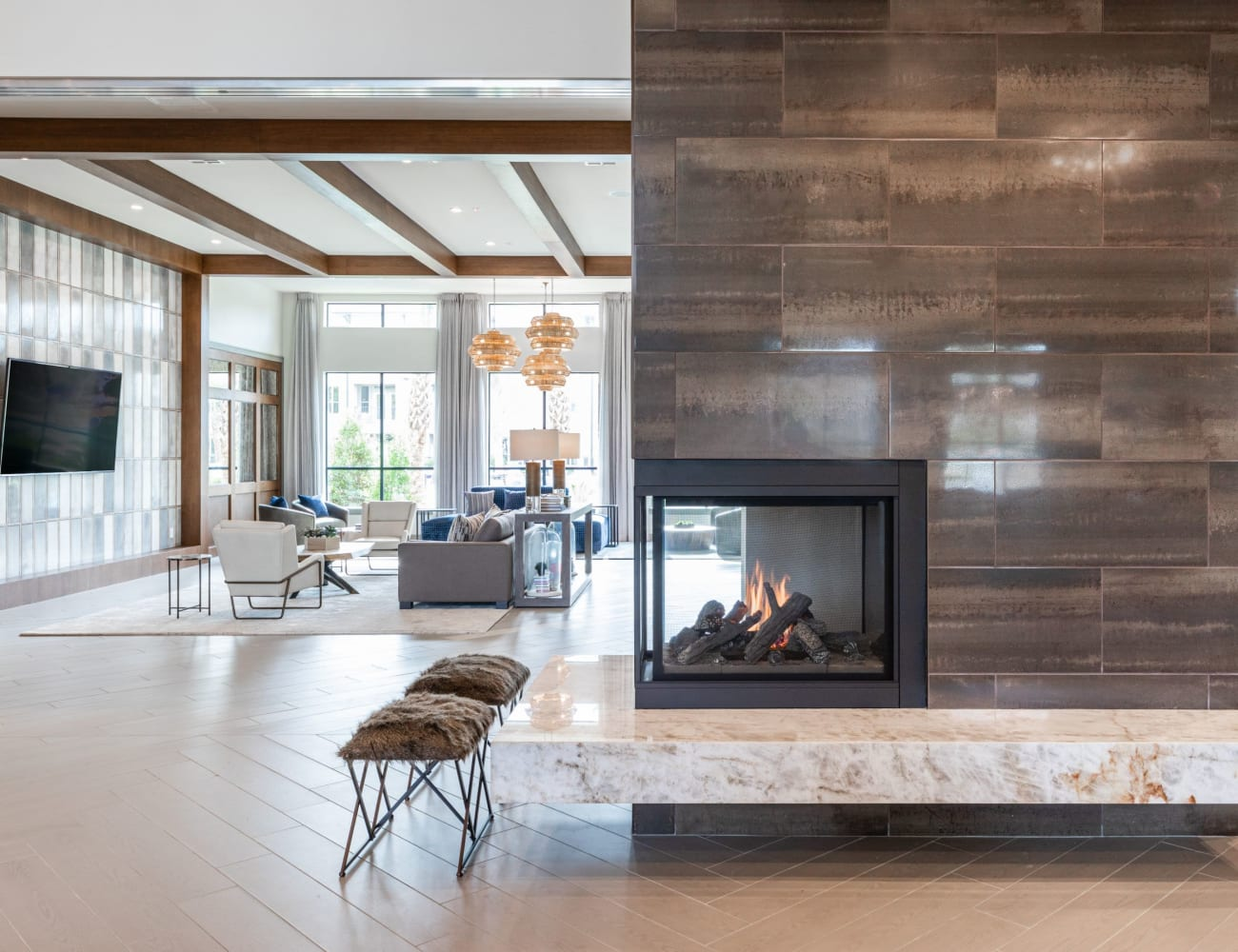Resident clubhouse with fireplace and more at Opal at Barker Cypress in Houston, Texas