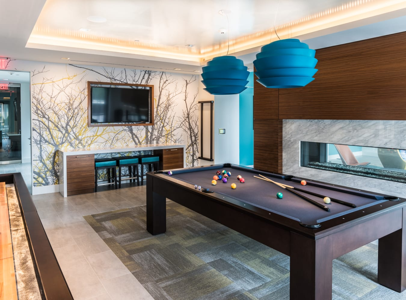 A billiards room with a TV at Solaire 7077 Woodmont in Bethesda, Maryland