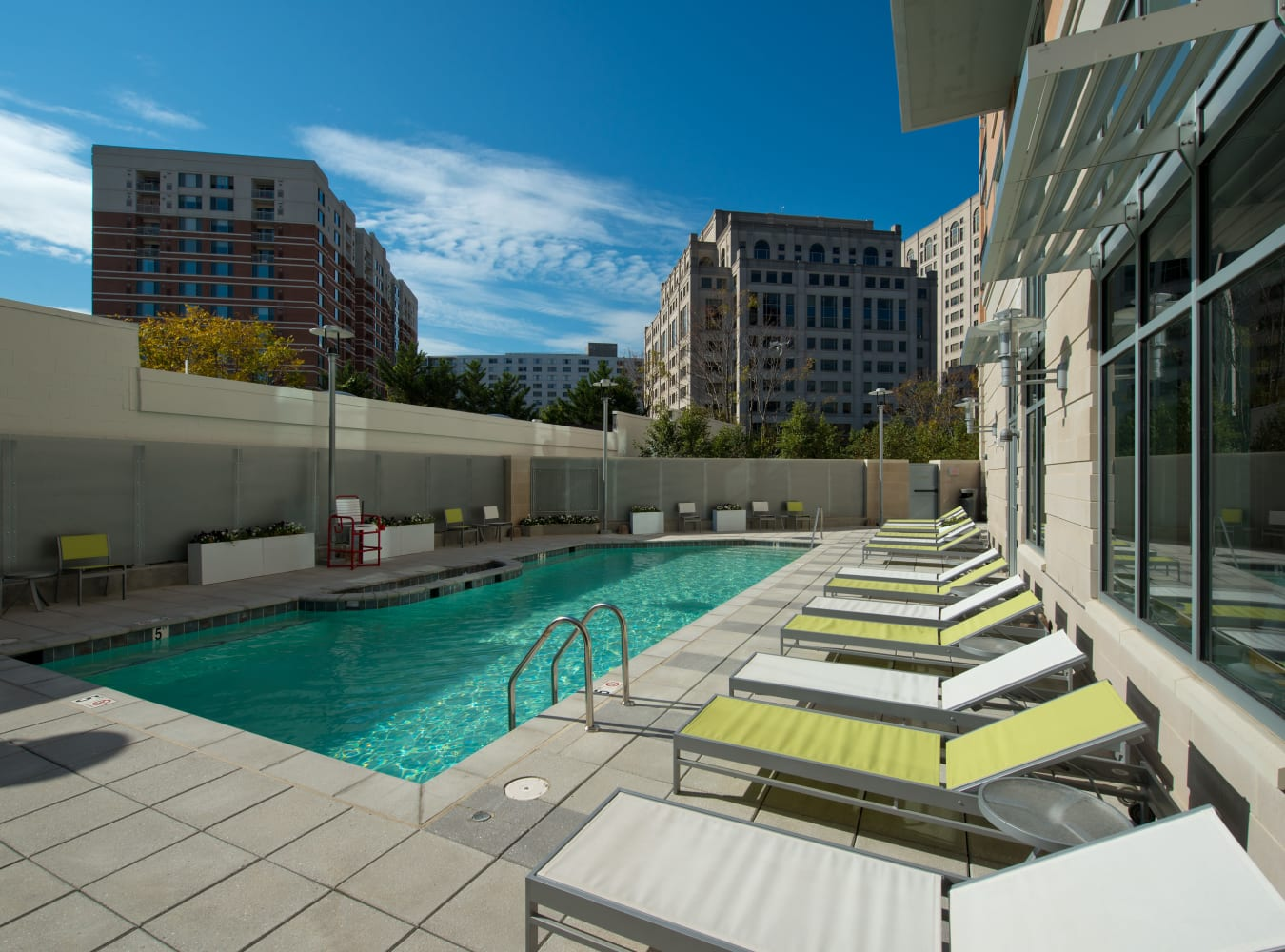 A resort-style swimming pool with lounge chairs at Solaire 1150 Ripley in Silver Spring, Maryland