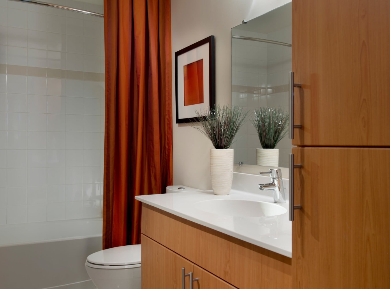 A modern bathroom with plenty of cabinet space at Solaire 1150 Ripley in Silver Spring, Maryland