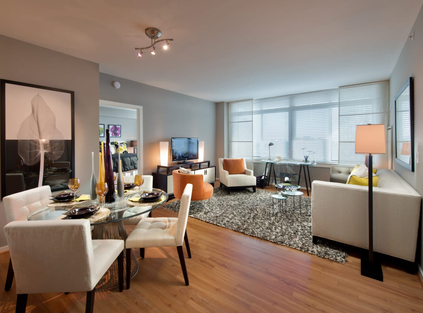 A spacious living room with wood-style flooring at Solaire 1150 Ripley in Silver Spring, Maryland