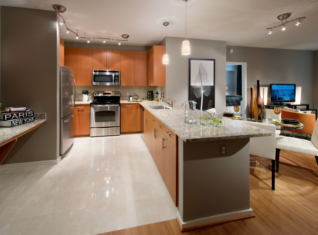A luxury kitchen with a breakfast bar at Solaire 1150 Ripley in Silver Spring, Maryland