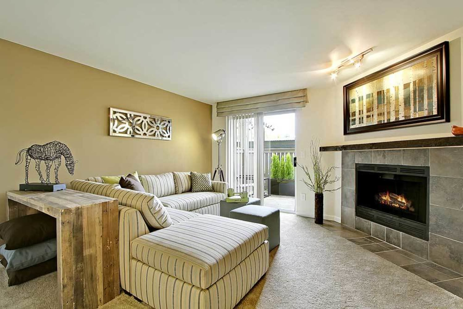 Living room with fireplace at Campbell Run Apartments in Woodinville, Washington