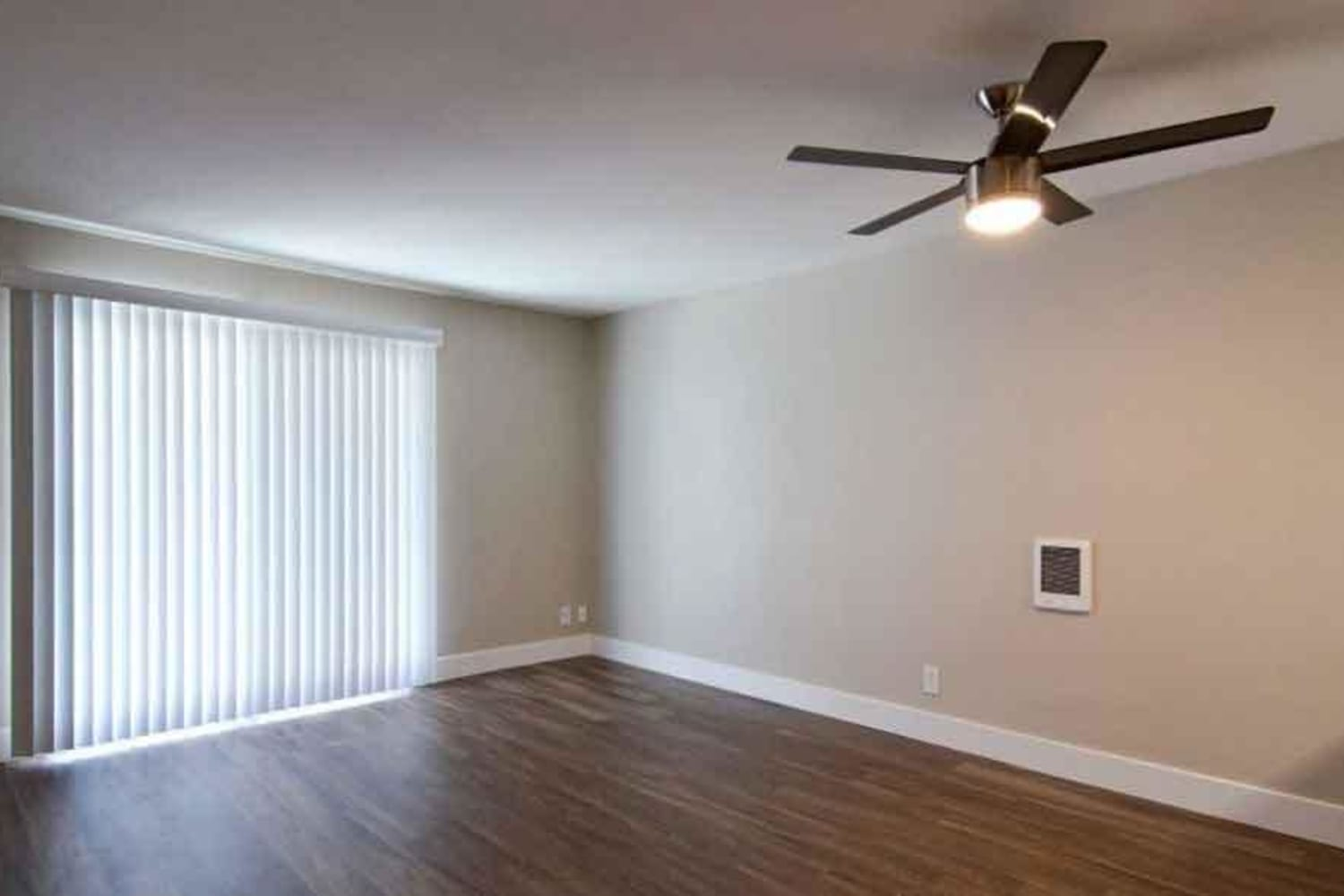 Hardwood floors and ceiling fans are offered at Harbor Cove Apartments in Foster City, California