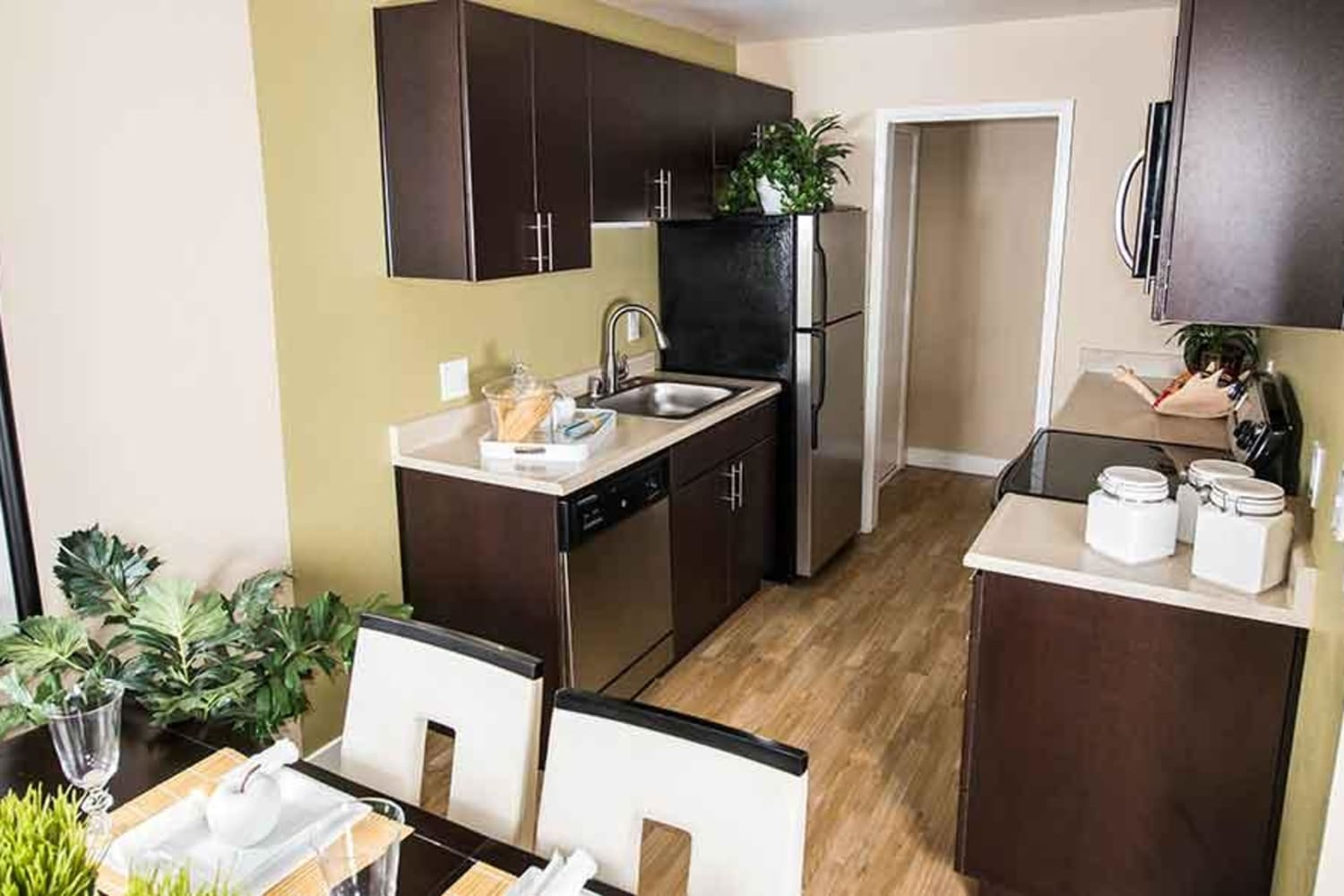 Enjoy room to entertain in your dining room and kitchen at Harbor Cove Apartments in Foster City, California