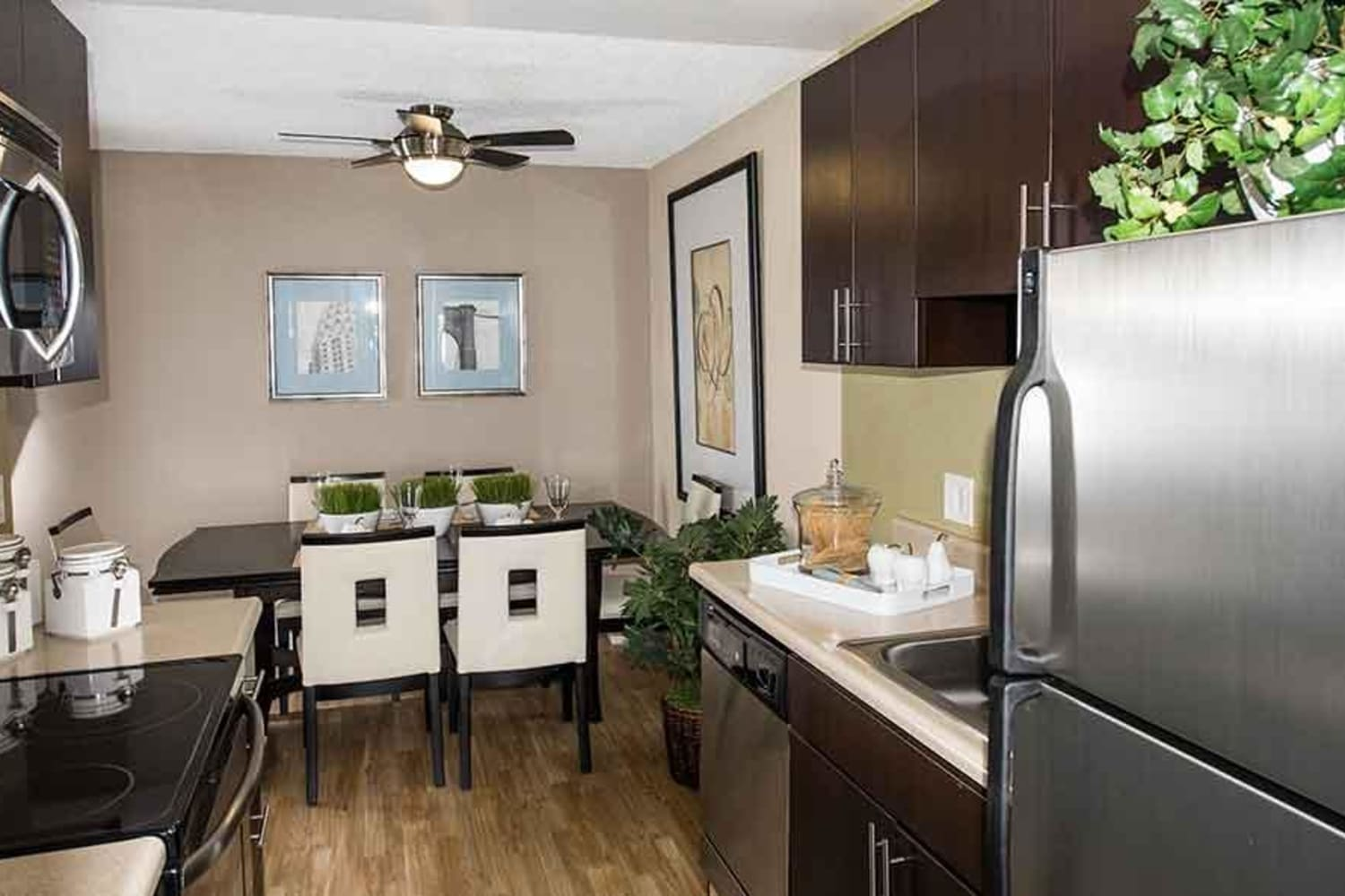 Kitchen with modern finishes at Harbor Cove Apartments in Foster City, California