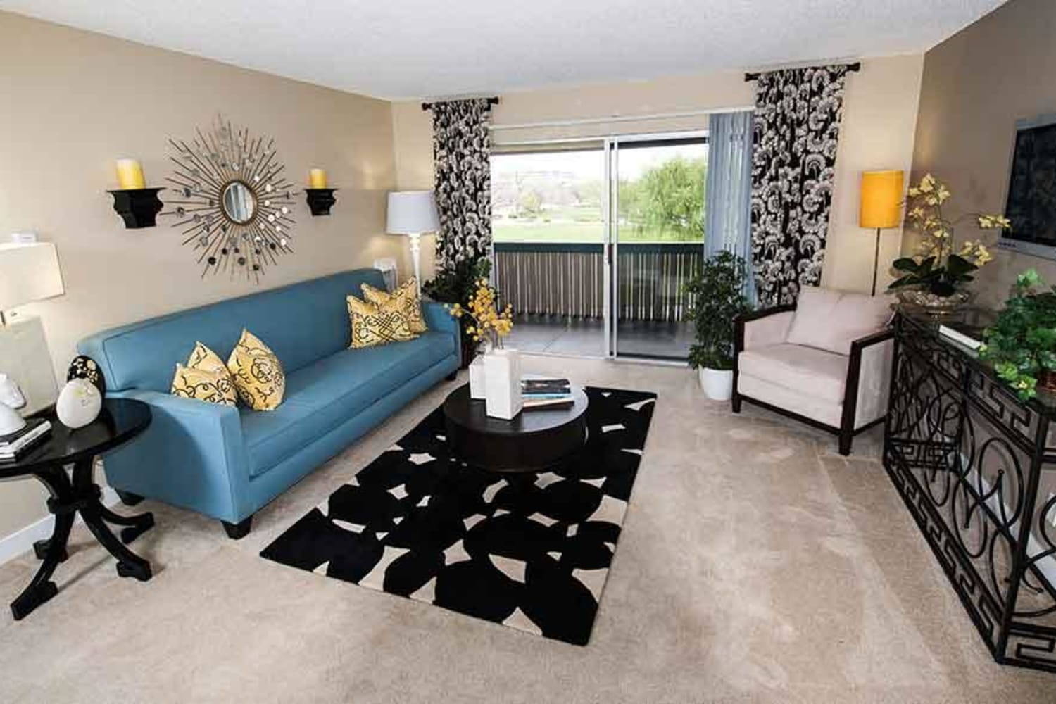 Enjoy a comfortable living space at Harbor Cove Apartments in Foster City, California, complete with a private patio