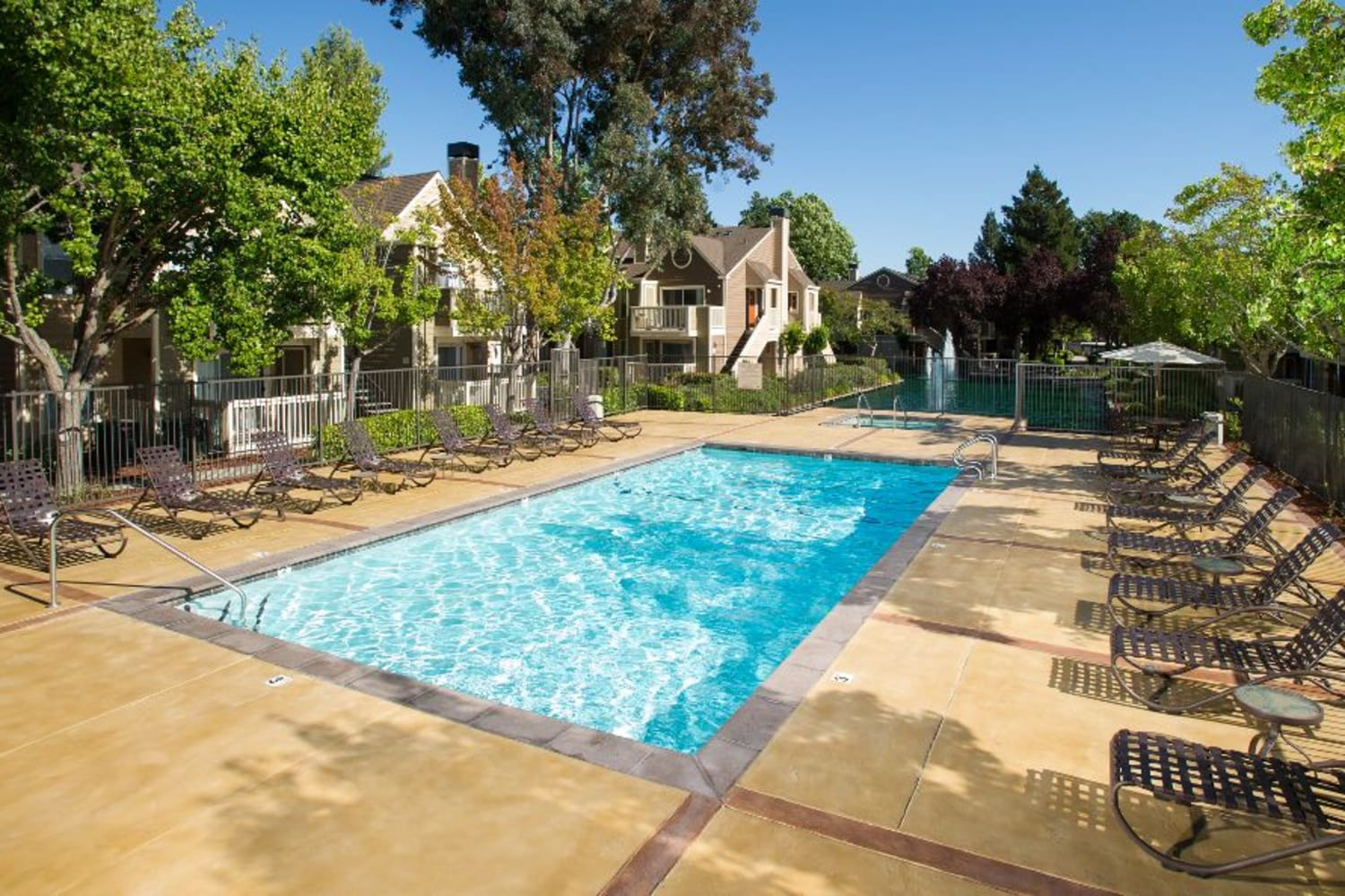 Soak up the sun by the sparkling swimming pool at Bridges at San Ramon in San Ramon, California