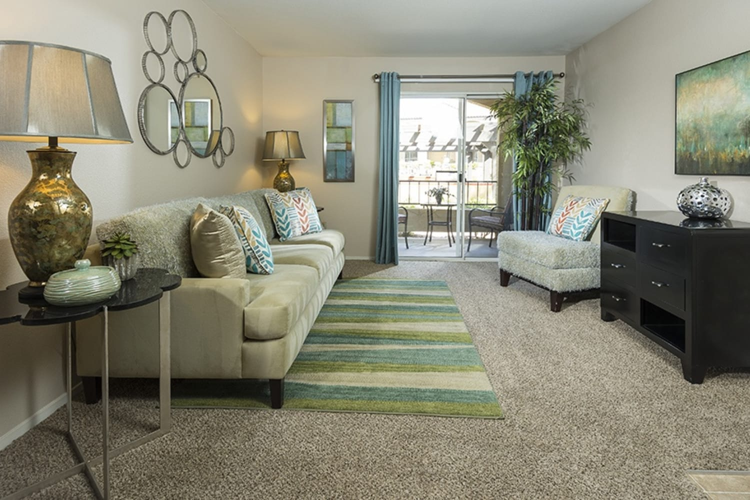 Plush carpeted living room at Rancho Destino Apartments in Las Vegas, Nevada