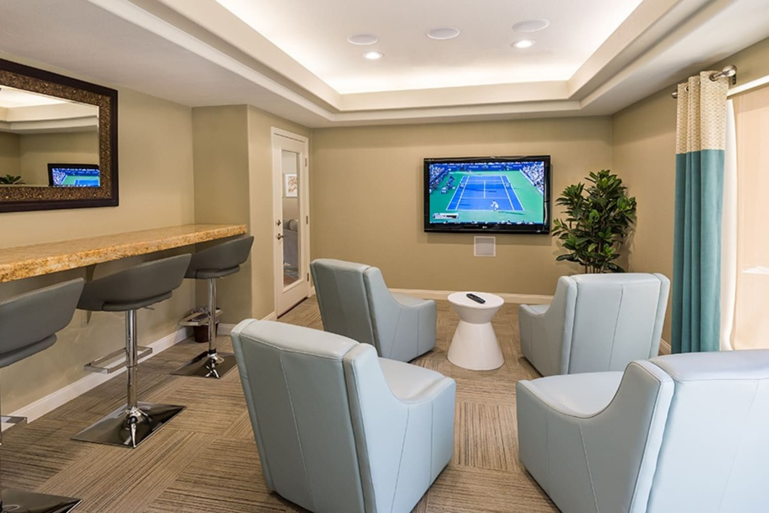 Watch movies in the the onsite theater room at Rancho Destino Apartments in Las Vegas, Nevada