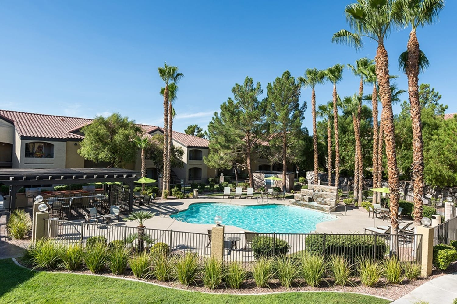 Swimming pool and palm trees at Rancho Destino Apartments in Las Vegas, Nevada