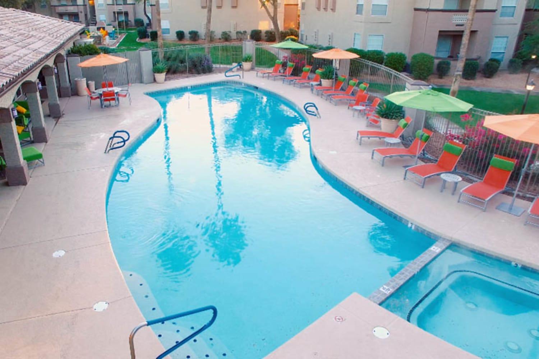 Sparkling swimming pool and hot tub at Ocotillo Bay Apartments in Chandler, Arizona
