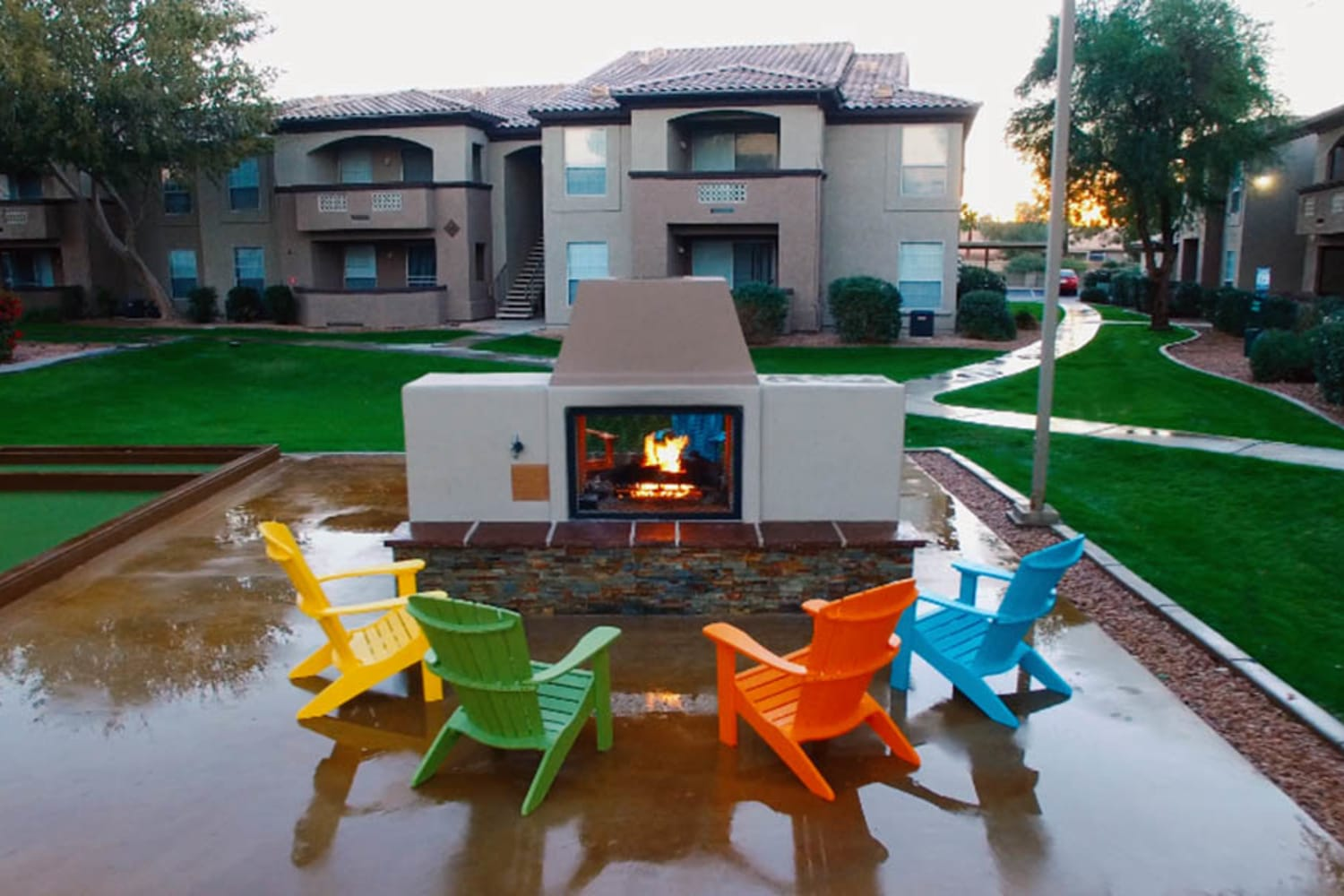 Outdoor fireplace and seating at Ocotillo Bay Apartments in Chandler, Arizona
