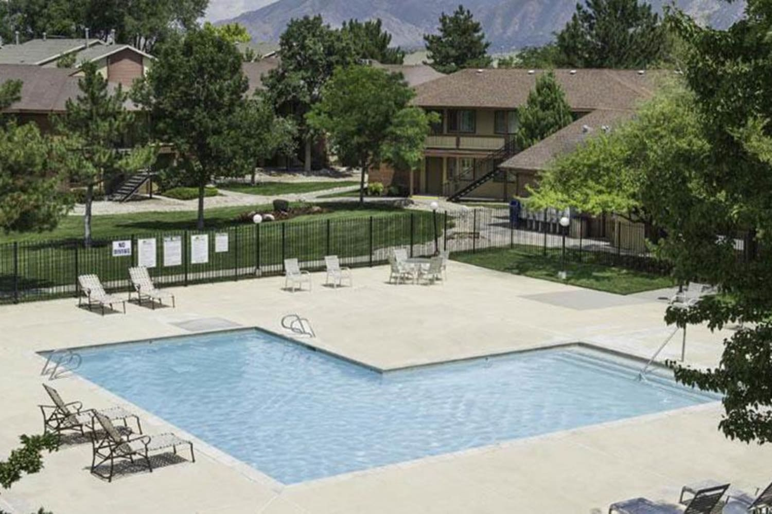 Sparkling swimming pool at Wasatch Club Apartments in Midvale, Utah