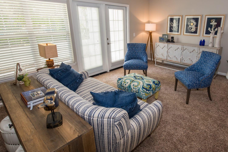 Carpeted living room at Nantucket Apartments in Santa Clara, California
