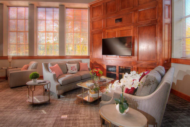 Large TV in resident center at Irving Schoolhouse Apartments in Salt Lake City, Utah