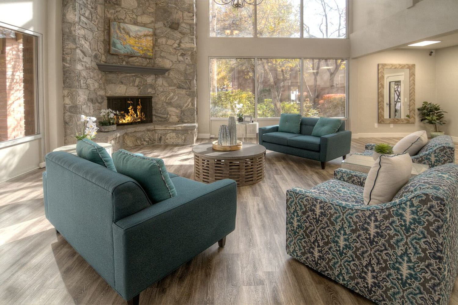 Enjoy a fireplace in the clubhouse at Wasatch Club Apartments in Midvale, Utah