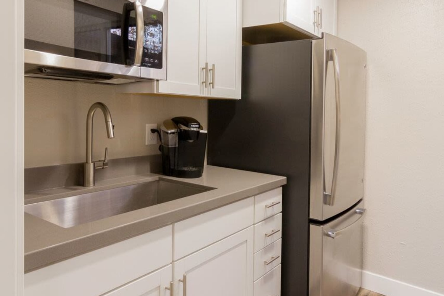 Stainless steel appliances in kitchens at Wasatch Club Apartments in Midvale, Utah
