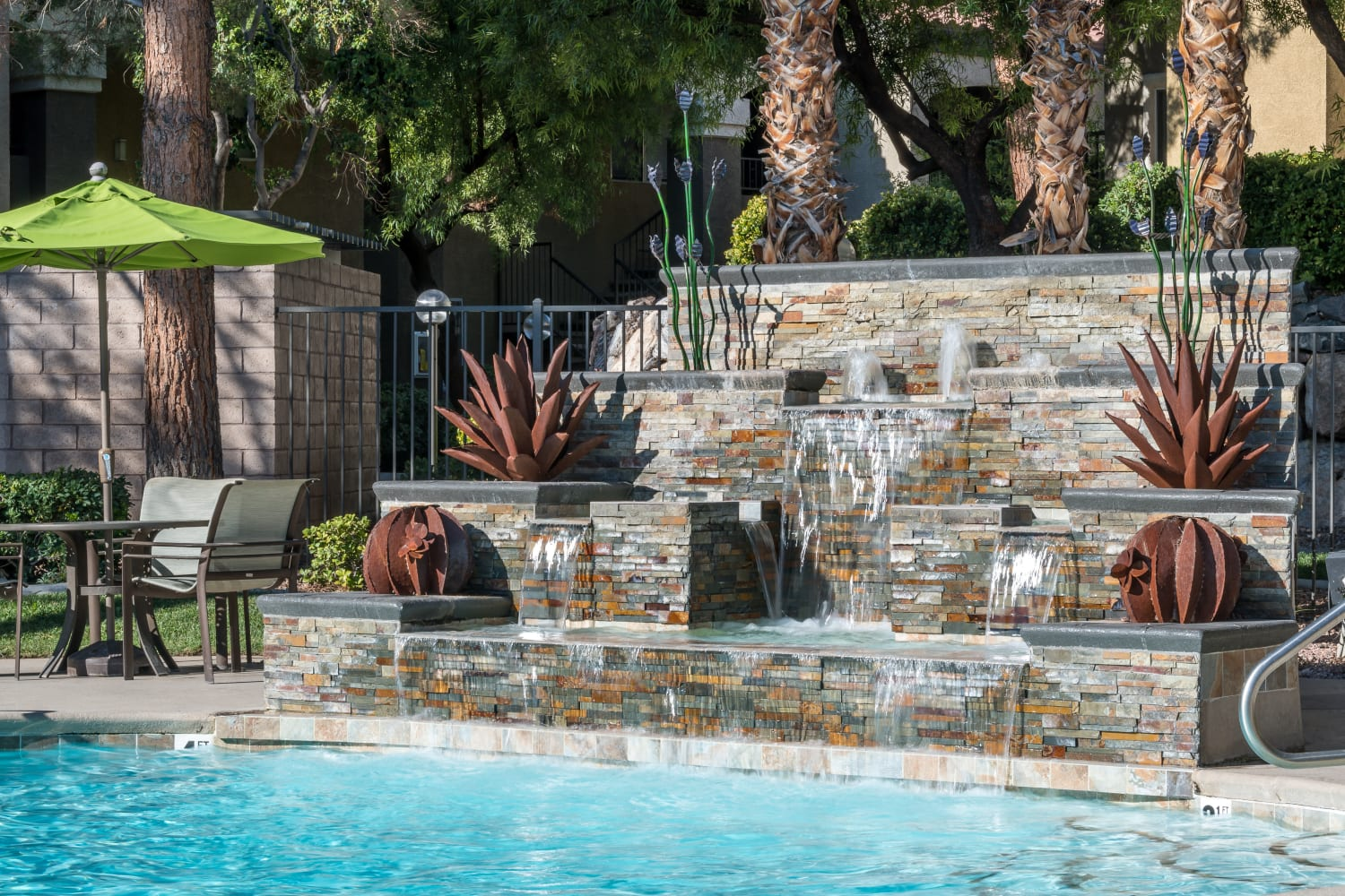 Swimming pool with waterfall feature at Rancho Destino Apartments in Las Vegas, Nevada