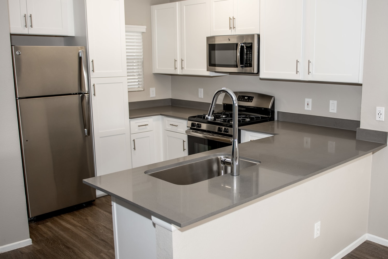 Madrid Apartments in Mission Viejo, California, offer modern kitchens with white cabinets